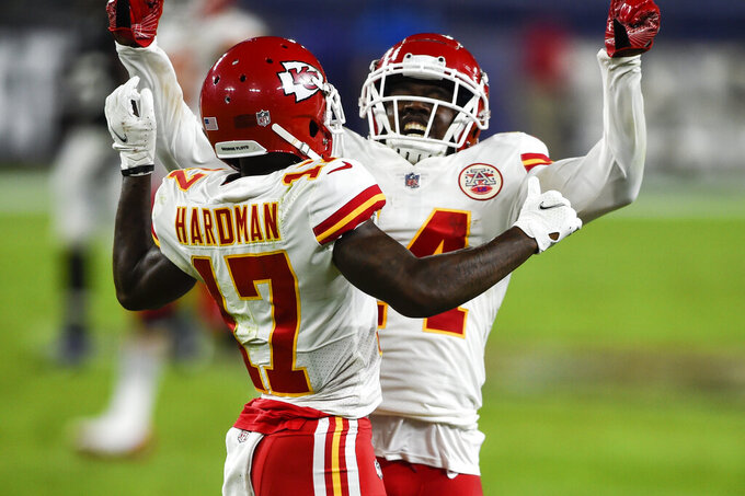 Kansas City Chiefs wide receivers Sammy Watkins (14) and Mecole Hardman (17) celebrate Hardman's touchdown during the first half of an NFL football game against the Baltimore Ravens, Monday, Sept. 28, 2020, in Baltimore. (AP Photo/Gail Burton)