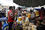People buys foodstuffs at a market in Lagos Saturday, Oct. 24, 2020. Nigeria's president says 51 civilians have been killed in unrest following days of peaceful protests over police abuses, and he blames