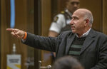 Hazem Mohammed gestures as he gives his victim impact statement during the sentencing hearing for Australian Brenton Harrison Tarrant at the Christchurch High Court after Tarrant pleaded guilty to 51 counts of murder, 40 counts of attempted murder and one count of terrorism in Christchurch, New Zealand, Tuesday, Aug. 25, 2020. More than 60 survivors and family members will confront the New Zealand mosque gunman this week when he appears in court to be sentenced for his crimes in the worst atrocity in the nation's modern history. (John Kirk-Anderson/Pool Photo via AP)