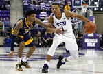 West Virginia guard James Bolden (3) defends as TCU guard Desmond Bane (1) works for a shot opportunity in the second half of an NCAA college basketball game, Tuesday, Jan. 15, 2019, in Fort Worth, Texas. Bane lead all scoring with 26 points in the 98-67 TCU win. (AP Photo/Tony Gutierrez)