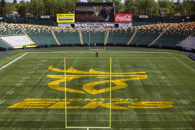 The Edmonton Elks Canadian Football League name and logo are displayed at Commonwealth Stadium in Edmonton, Alberta, Tuesday, June 1, 2021. The Edmonton CFL franchise has changed its team name to Elks. Edmonton dropped its longtime name, Eskimos, last year following a similar decision by the NFL's Washington team amid pressure on franchises to eliminate racist or stereotypical names. (Jason Franson/The Canadian Press via AP)