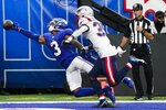 New York Giants' Sterling Shepard (3) dives for the ball in the end zone as New England Patriots cornerback Mike Jackson (35) defends him during the first half of an NFL preseason football game Sunday, Aug. 29, 2021, in East Rutherford, N.J. The pass was incomplete. (AP Photo/John Minchillo)
