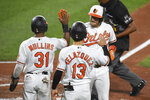 Baltimore Orioles' Jose Iglesias, right, celebrates his home run with Cedric Mullins (31) and Andrew Velazquez (13) during the third inning of a baseball game against the Atlanta Braves, Monday, Sept. 14, 2020, in Baltimore. (AP Photo/Terrance Williams)
