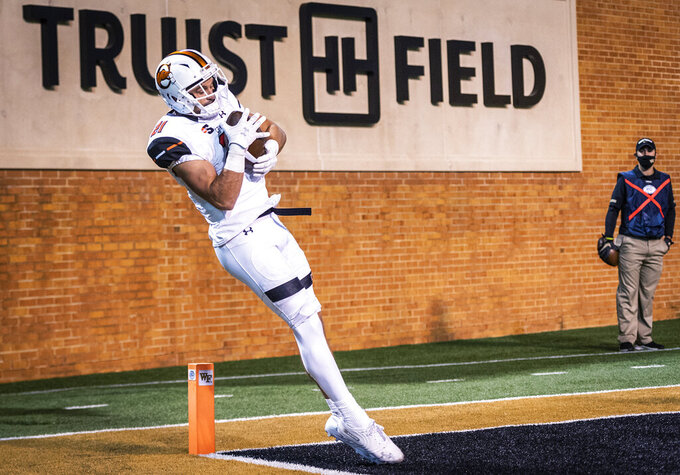 Campbell wide receiver Mason Donaldson (21) catches a touchdown pass against Wake Forest during an NCAA college football game Friday, Oct. 2, 2020, in Winston-Salem, N.C. (Andrew Dye/The Winston-Salem Journal via AP)