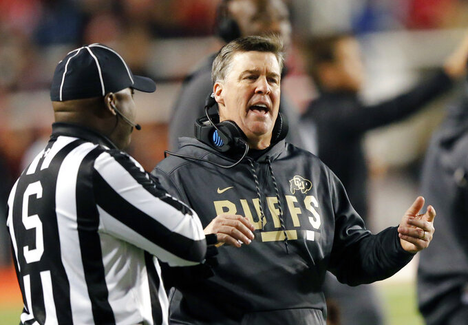 FILE - In this Saturday, Nov. 25, 2017 file photo, Colorado coach Mike MacIntyre reacts on the sideline during the first half of the team's NCAA college football game against Utah, in Salt Lake City. Nebraska faces former Big 12 rival Colorado in its opener. The Cornhuskers were supposed to open against Akron last week but the game was called off because of inclement weather. Colorado comes to Lincoln off a big win over Colorado State. Colorado plays Nebraska on Saturday, Sept. 8, 2018. (AP Photo/Rick Bowmer, File)