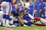 New York Giants quarterback Daniel Jones, center bottom is tackled by the Arizona Cardinals defense during the second half of an NFL football game, Sunday, Oct. 20, 2019, in East Rutherford, N.J. (AP Photo/Adam Hunger)