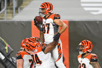 Cincinnati Bengals tight end C.J. Uzomah (87) celebrates with teammates after touchdown during the first half of the team's NFL football game against the Cleveland Browns, Thursday, Sept. 17, 2020, in Cleveland. (AP Photo/David Richard)