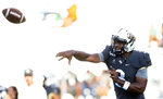 Central Florida quarterback Brandon Wimbush (3) warms up before an NCAA college football game against Florida A&M, Thursday, Aug. 29, 2019, in Orlando, Fla. (AP Photo/Willie J. Allen Jr.)