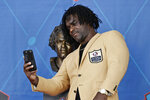 Edgerrin James, a member of the Pro Football Hall of Fame Centennial Class, takes a selfie with his bust during the induction ceremony at the Pro Football Hall of Fame, Saturday, Aug. 7, 2021, in Canton, Ohio. (AP Photo/Ron Schwane, Pool)