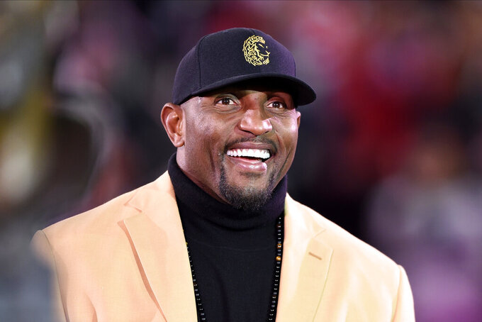 FILE - In this Nov. 3, 2019, file photo, former Baltimore Ravens linebacker Ray Lewis looks on during a halftime ceremony presenting former safety Ed Reed with his Pro Football Hall of Fame ring during an NFL football game between the Ravens and the New England Patriots in Baltimore. Two sons of pro football Hall of Famer Ray Lewis have announced on social media they will transfer to play at Kentucky.  Rayshad Lewis and Rahsaan Lewis announced their decisions Wednesday, Aug. 5, 2020, on verified Twitter accounts. A Wildcats football spokeswoman says the brothers are confirmed walk-ons. (AP Photo/Gail Burton, File)