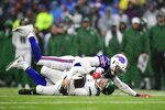 FILE - In this Dec. 29, 2019, file photo, Buffalo Bills defensive end Trent Murphy sacks New York Jets quarterback Sam Darnold during the first half of an NFL football game in Orchard Park, N.Y. Darnold has flashed some promise with his playmaking abilities as well as showing some inconsistency. (AP Photo/David Dermer, File)