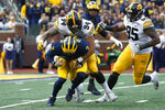 Iowa defensive end A.J. Epenesa (94) sacks Michigan quarterback Shea Patterson (2) during the first half of an NCAA college football game in Ann Arbor, Mich., Saturday, Oct. 5, 2019. (AP Photo/Paul Sancya)