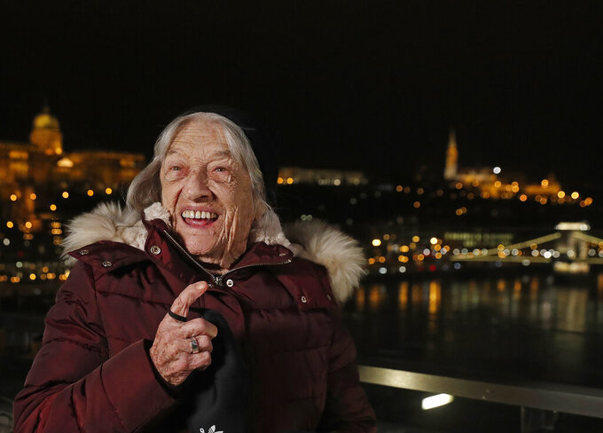 Agnes Keleti, former Olympic gold medal winning gymnast, poses in Budapest, Hungary Monday Jan. 4, 2021. The oldest living Olympic champion turns 100 and says the fondest memory of her remarkable life is simply that she has lived through it all. Agnes Keleti is a Holocaust survivor and winner of five Olympic gold medals in gymnastics and 10 overall. (AP Photo/Laszlo Balogh)
