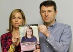 FILE - In this May 2, 2012 file photo, Kate and Gerry McCann pose for the media with a missing poster depicting an age progression computer generated image of their daughter Madeleine at nine years of age, to mark her birthday and the 5th anniversary of her disappearance during a family vacation in southern Portugal in May 2007, during a news conference in London. Madeleine McCann's family is hoping for closure in the case after a key suspect was identified in Germany and as authorities there say they believe the missing British girl is dead. (AP Photo/Sang Tan, File)