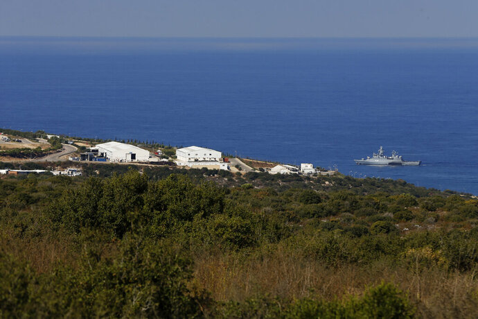 A UNIFIL Navy ship patrols in the Mediterranean Sea next to a base of the U.N. peacekeeping force, off the southern town of Naqoura, Lebanon, Wednesday, Oct. 14, 2020. Lebanon and Israel are to begin indirect talks Wednesday over their disputed maritime border, with American officials mediating the talks that both sides insist are purely technical and not a sign of any normalization of ties. (AP Photo/Bilal Hussein)