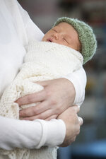 New Zealand Prime Minister Jacinda Ardern holds her newly born baby girl, Neve, at Auckland Hospital on Sunday, June 24, 2018. Ardern made her first public appearance on Sunday since giving birth to her daughter on Thursday. Ardern is just the second elected world leader to give birth while holding office. (Greg Bowker/New Zealand Herald via AP)