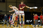 Stanford forward James Keefe, left, celebrates with Neal Begovich after Stanford defeated Arizona in an NCAA college basketball game in Santa Cruz, Calif., Saturday, Dec. 19, 2020. (AP Photo/Jeff Chiu)