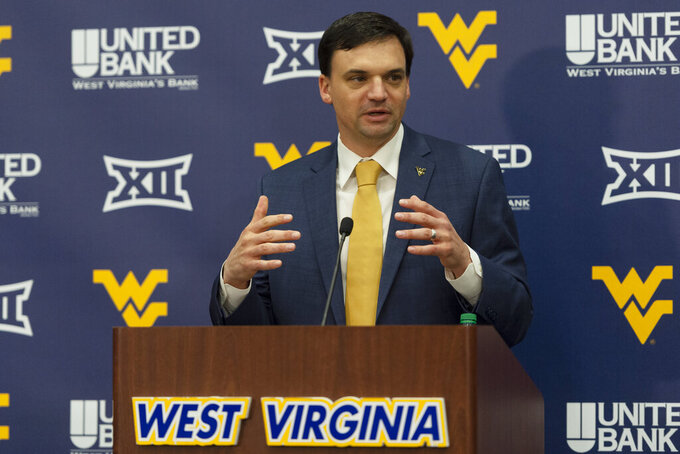 West Virginia University's new NCAA college football head coach Neal Brown gestures during a press conference in Morgantown, W.Va., Thursday, Jan. 10, 2019. (Craig Hudson/The Charleston Gazette-Mail via AP