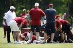 Washington Redskins linebacker Reuben Foster is tended to after suffering an injury during a practice at the team's NFL football practice facility, Monday, May 20, 2019, in Ashburn, Va. (AP Photo/Patrick Semansky)