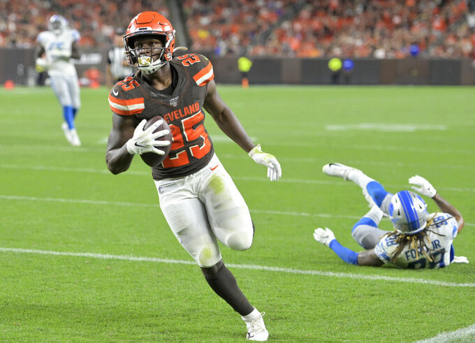 Cleveland Browns running back Dontrell Hilliard (25) runs for a 7-yard touchdown during the first half of the team's NFL preseason football game against the Detroit Lions, Thursday, Aug. 29, 2019, in Cleveland. (AP Photo/David Richard)