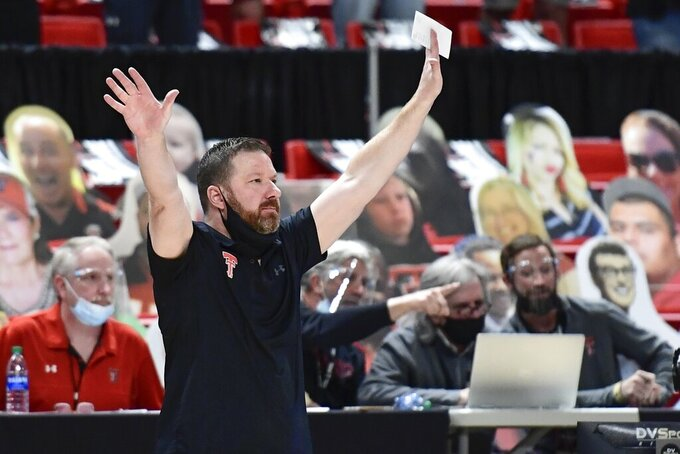 FILE - In this Feb. 27, 2021, file photo, Texas Tech head coach Chris Beard reacts on the sideline during the second half of an NCAA college basketball game in Lubbock, Texas Feb. Utah State and Texas Tech meet in a first-round game in the South Region on Friday. (AP Photo/Justin Rex, File)