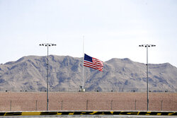 A flag flies at half staff to honor Supreme Court Justice Ruth Bader Ginsburg before the start of a NASCAR Cup Series auto race Sunday, Sept. 27, 2020, in Las Vegas. The race was run without fans due to COVID-19. (AP Photo/Isaac Brekken)