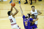 Indiana's Jerome Hunter (21) shoots over Tennessee Tech's Shandon Goldman (33) during the second half of an NCAA college basketball game, Wednesday, Nov. 25, 2020, in Bloomington, Ind. (AP Photo/Darron Cummings)