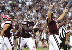 Mississippi State quarterback Nick Fitzgerald (7) celebrates his first touchdown of the day as teammates Austin Williams, left, and Greg Eiland, center, come in to congratulate him during the first half of their NCAA college football game against Louisiana-Lafayette on Saturday, Sept. 15, 2018, in Starkville, Miss. (AP Photo/Jim Lytle)