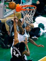 Boston Celtics' Al Horford blocks a shot by Milwaukee Bucks' Giannis Antetokounmpo (34) during the third quarter of Game 1 of an NBA basketball first-round playoff series, in Boston, Sunday, April 15, 2018. (AP Photo/Michael Dwyer)