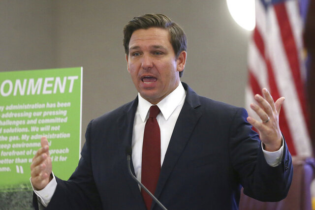 FILE - In this Oct. 29, 2019 file photo, Gov. Ron DeSantis speaks at pre-legislative news conference on in Tallahassee, Fla.  The state of Florida is asking a U.S. appellate court in Georgia to set aside an earlier judge's ruling that allowed some impoverished felons to regain access to the ballot box, despite owing fines and other legal debts.  The matter that will play out Tuesday, Jan. 28, 2020 before the Atlanta-based 11th Circuit of the U.S. Court of Appeals is far from inconsequential because of the razor-thin margins that sometimes decide election contests in Florida, a perennial battleground state.(AP Photo/Steve Cannon, File)