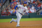 New York Mets' Michael Conforto runs to third on a double by Kevin Pillar during the second inning of the team's baseball game against the Washington Nationals on Friday, Sept. 3, 2021, in Washington. (AP Photo/Nick Wass)