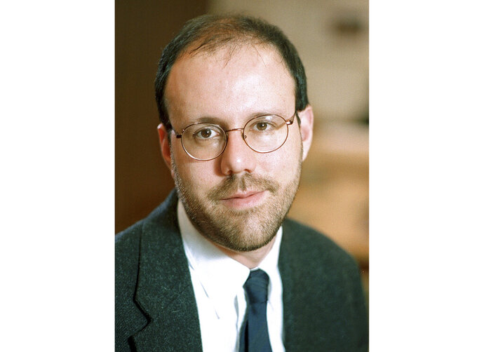 This undated photo provided by Harvard University shows Michael Kremer, professor of economics at the college in Cambridge, Mass., who was awarded 2019 Nobel Prize in economics along with Abhijit Banerjee and Esther Duflo Monday, Oct. 14, 2019, for pioneering new ways to alleviate global poverty. (Jon Chase/Harvard University News Office via AP)