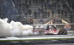 Kyle Busch does a burnout after winning the NASCAR Truck Series auto race at Atlanta Motor Speedway, Saturday, Feb. 23, 2019, in Hampton, Ga. (AP Photo/John Amis)