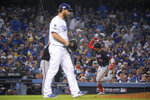 Washington Nationals' Juan Soto celebrates after a home run off Los Angeles Dodgers pitcher Clayton Kershaw during the eighth inning in Game 5 of a baseball National League Division Series on Wednesday, Oct. 9, 2019, in Los Angeles. (AP Photo/Mark J. Terrill)