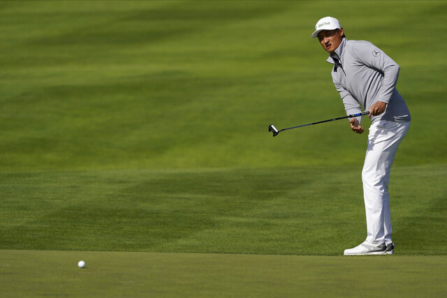 Li Haotong of China, watches his putt on the 10th hole during the second round of the PGA Championship golf tournament at TPC Harding Park Friday, Aug. 7, 2020, in San Francisco. (AP Photo/Charlie Riedel)