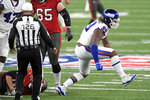 New York Giants' Leonard Williams, right, celebrates after sacking Tampa Bay Buccaneers quarterback Tom Brady during the first half of an NFL football game, Monday, Nov. 2, 2020, in East Rutherford, N.J. (AP Photo/Bill Kostroun)