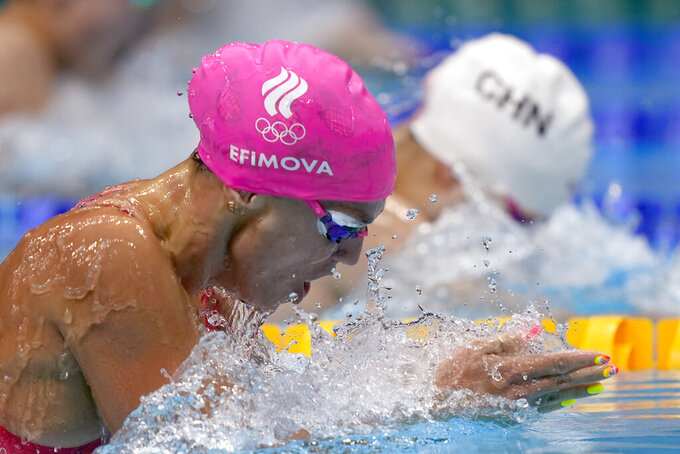 Yuliya Efimova of the Russian Olympic Committee swims in a heat during the women's 100-meter breaststroke at the 2020 Summer Olympics, Sunday, July 25, 2021, in Tokyo, Japan. (AP Photo/Martin Meissner)