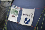 A tent is decorated with banners demanding to change the climate policy in a small camp where climate activists on a hunger strike near the chancellery in Berlin, Wednesday, Sept. 22, 2021. With the hunger strike the climate activists hope to pressure candidates for chancellor of Germany into meeting them for a debate about the climate crisis ahead Sunday's general election. For the first time in Germany's history, climate change is a central issue of an election campaign, overwhelmingly so for the young generation.(AP Photo/Markus Schreiber)