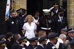 Elizabeth French, center, and her son Andrew, left, follow the casket of her daughter, Chicago police officer Ella French, after a funeral service at the St. Rita of Cascia Shrine Chapel Thursday, Aug. 19, 2021, in Chicago. French was killed and her partner was seriously wounded during an Aug. 7 traffic stop on the city's South Side. (AP Photo/Charles Rex Arbogast)