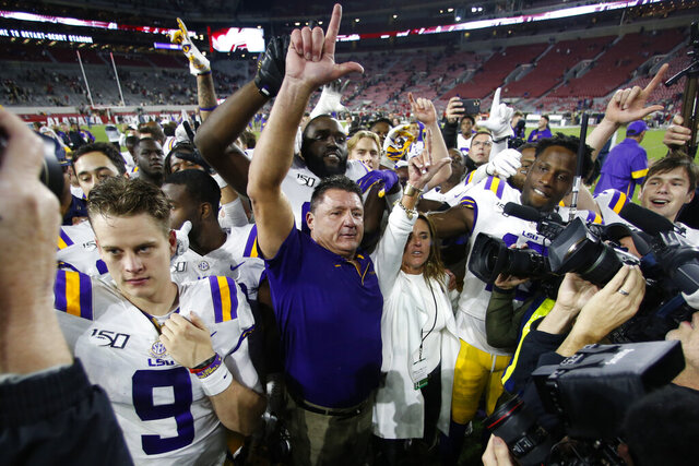 FILE - In this Nov. 9, 2019, file photo, LSU head coach Ed Orgeron celebrates with his players after defeating Alabama 46-41 in an NCAA college football game in Tuscaloosa, Ala. (AP Photo/John Bazemore, File)