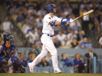 Los Angeles Dodgers' Cody Bellinger watches his two-run home run during the fourth inning of a baseball game against the Chicago Cubs in Los Angeles, Thursday, June 13, 2019. (AP Photo/Kyusung Gong)