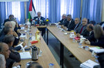 Palestinian Prime Minister Mohammed Shtayyeh, center, chairs a cabinet meeting in the Jordan Valley village of Fasayil, Monday, Sept. 16, 2019. Israeli Prime Minister Benjmin Netanyahu has vowed to annex