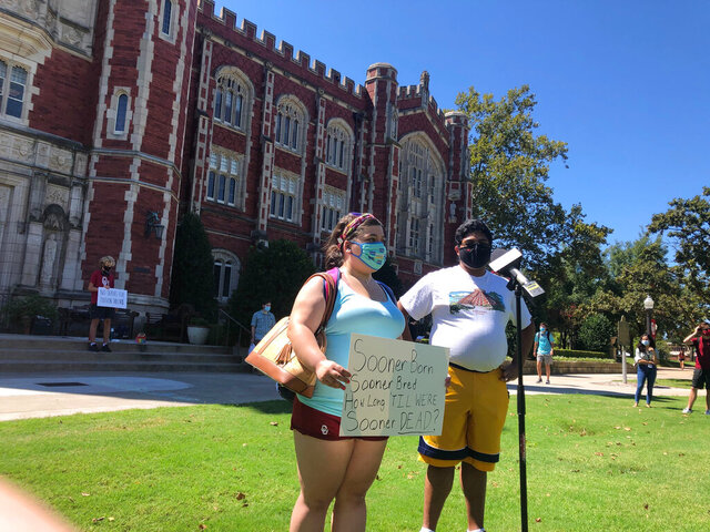 Kellie Dick, left, a University of Oklahoma senior from Shawnee, Okla., and Abhi Nath, a senior from Norman, voice their concerns about OU's handling of the coronavirus pandemic during a student demonstration, Thursday, Sept. 3, 2020, in Norman, Okla. (AP Photo/Sean Murphy)