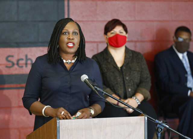 Columbus City Schools Superintendent Talisa Dixon announces all-online schooling for all students to start the 2020-21 school year during a news conference at Downtown High School in Columbus on Tuesday, July 28, 2020. (Adam Cairns/The Columbus Dispatch via AP)