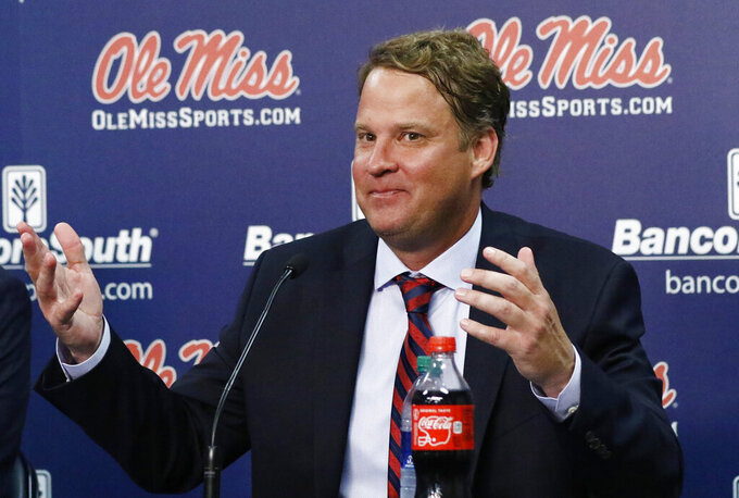 FILE - In this Dec. 9, 2019, file photo, Lane Kiffin responds to reporters questions at a news conference, after being introduced to Mississippi fans as their new NCAA college football coach in Oxford, Miss. Kiffin is trying to lead Ole Miss to a rebound from a 4-8 season. (AP Photo/Rogelio V. Solis, File)