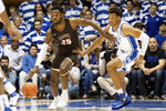 Brown's Tamenang Choh, left, dribbles the ball past Duke's Wendell Moore Jr., right, during the first half of an NCAA college basketball game in Durham, N.C., Saturday, Dec. 28, 2019. (AP Photo/Ben McKeown)