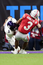 Northwestern wide receiver Charlie Fessler (5) begins to fumble as he is tackled by Ohio State cornerback Damon Arnette (3) during the second half of the Big Ten championship NCAA college football game, Saturday, Dec. 1, 2018, in Indianapolis. After review, Fessler was ruled down before the fumble and Northwestern maintained in position of the ball. (AP Photo/AJ Mast)