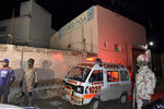 Pakistani paramilitary troops and an ambulance arrive at the site of bomb explosion in a mosque in Quetta, Pakistan, Friday, Jan. 10, 2020. A powerful explosion ripped through a mosque in southwest Pakistan during Friday evening prayers, killing a senior police officer with some civilians and wounded other worshipers, police said. (AP Photo/Arshad Butt)