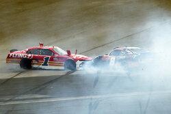 Michael Annett (1) and Sam Mayer (8) crash during the early laps of the restart of the NASCAR Xfinity Series auto race at Daytona International Speedway, Saturday, Aug. 28, 2021, in Daytona Beach, Fla. (AP Photo/David Graham)