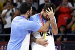 Facundo Campazzo of Argentina, left, hugs teammate Nicolas Laprovittola during the silver-medal ceremony after their loss to Spain in their first-place match in the FIBA Basketball World Cup at the Cadillac Arena in Beijing, Sunday, Sept. 15, 2019. (AP Photo/Mark Schiefelbein)